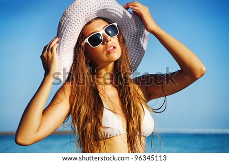Woman on the beach, bali - stock photo