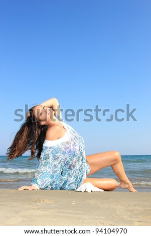 Woman on the beach enjoying the summer