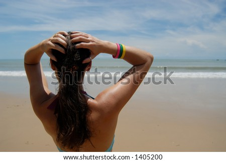 woman on the beach in the tropics