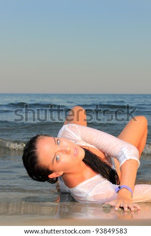 Woman on the beach laying down enjoying the summertime