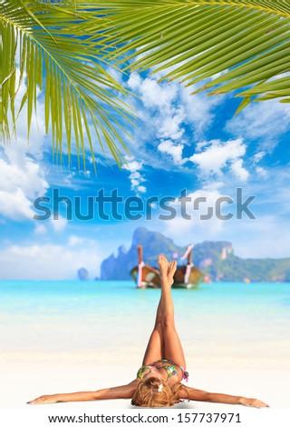 Woman on the beach on Ko Phi Phi island in Thailand - stock photo
