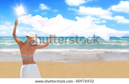 woman on the beach with a white sarong - stock photo