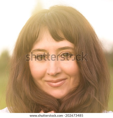 Woman on the countryside evening background.  - stock photo