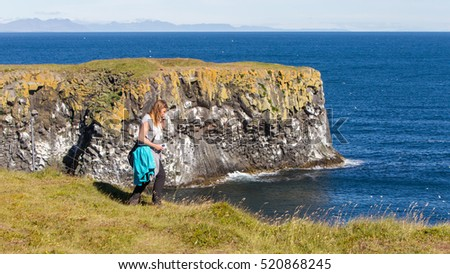 Woman on the edge of the cliff - Westcoast of Iceland