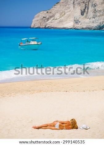 WOman on The famous Navagio Shipwreck beach in Zakynthos island Greece - stock photo