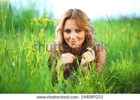 woman on the green grass happy and smile - stock photo