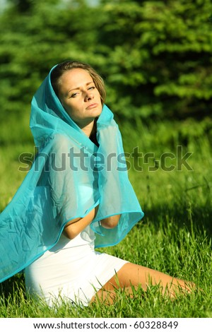 woman on the green grass happy and smile