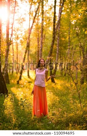 Woman on the hill enjoying beautiful summer sunset. - stock photo