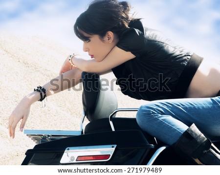 woman on the old fashion motorbike - stock photo