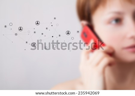 Woman on the phone with added graphic connection icon, blurred - stock photo