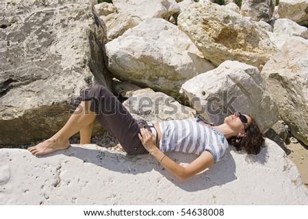 Woman on the rocks. - stock photo