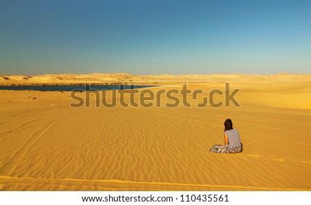 Woman on the sand in desert. Egypt. - stock photo