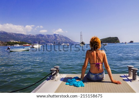 woman on the sea platform - stock photo