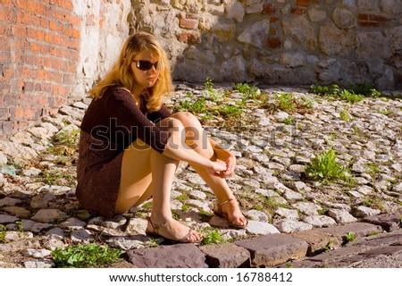 Woman on the stones - stock photo