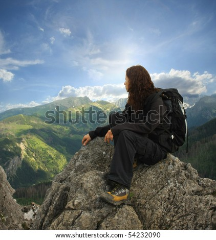 woman on the top of a high mountain - stock photo