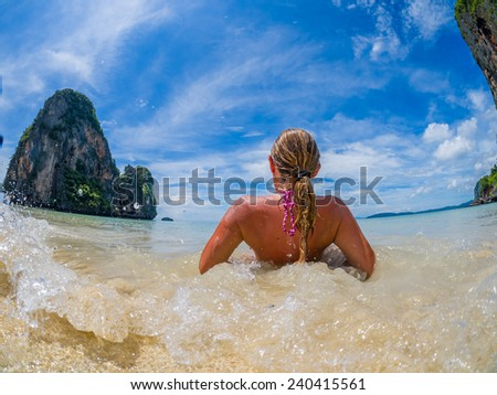 Woman on the tropical beach of Railay beach thailand