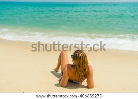 woman on the tropical  beach on a sunnt day