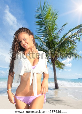 Woman on the Tropical beach  under the coconut tree in Koh Samui island in Thailand - stock photo