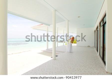 woman on the veranda of the tropical house - stock photo