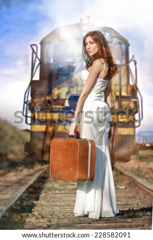 Woman on train tracks - stock photo
