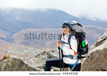 Woman on trekking trip in Himalaya Mountains in Nepal, holidays and vacations