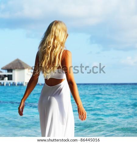 woman on tropical beach - stock photo