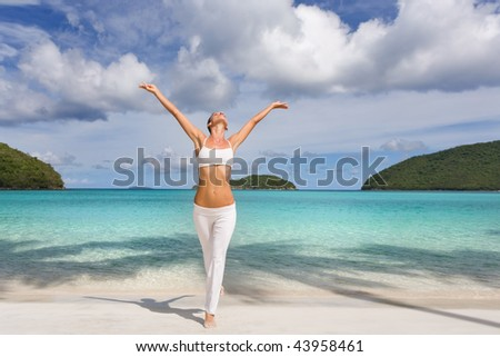 woman on tropical resort beach in white yoga outfit relaxing on exotic caribbean island healthy and fit