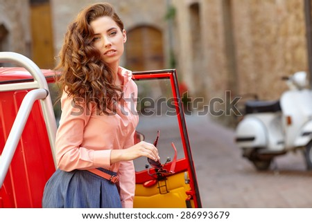 Woman on typical italian street in small  old town
