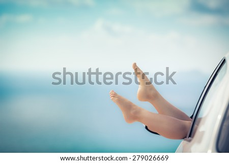 Woman on vacation. Summer holiday and car travel concept - stock photo