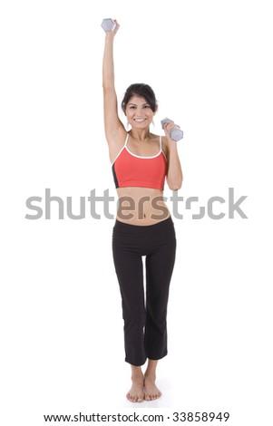 Woman on white holding silver dumbbells doing presses. - stock photo