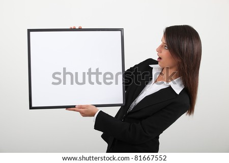 woman open-mouthed in surprise - stock photo