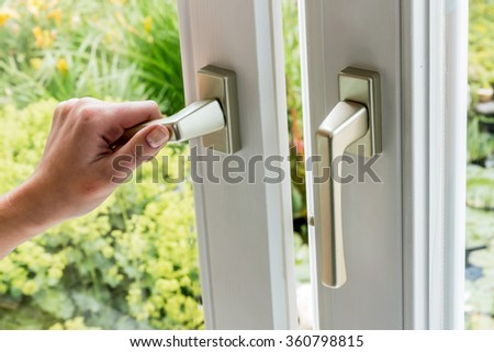 woman opens window for ventilation - stock photo