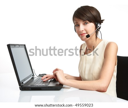woman operator with headset (microphone and headphones) working - using a notebook - stock photo