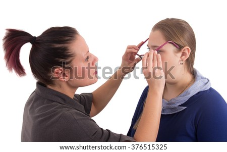woman optician adjust glasses studio shot over white background - stock photo