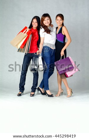 Woman or shopping woman happy smiling holding shopping bags