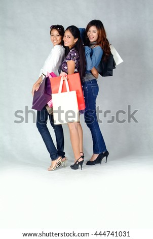 Woman or woman holding many shopping bags