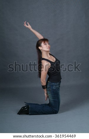Woman or woman yoga posing on background - stock photo