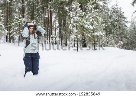 Woman outdoors at winter forest