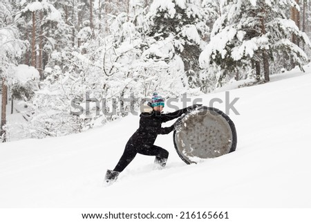 Woman outdoors at winter forest - stock photo