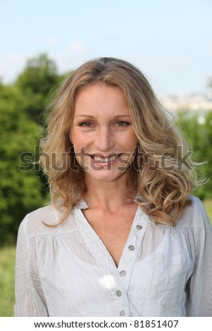 Woman outside smiling - stock photo