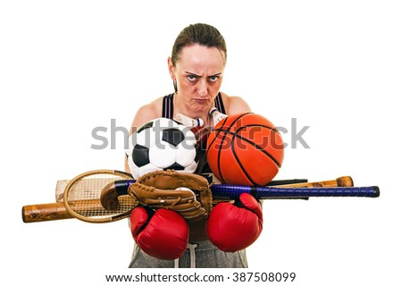 Woman overloaded with sports equipment. Soccer ball, basketball, baseball, boxing gloves, hockey stick, tennis racket, cricket bat, badminton shuttlecocks, squash. White background with copy space. - stock photo
