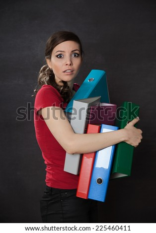 Woman overloaded with work. Chalkboard background
