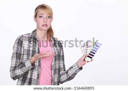 Woman overwhelmed by choice - stock photo