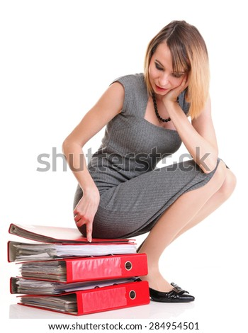 woman Overworked businesswoman sitting on pile of documents isolated white red folder - stock photo