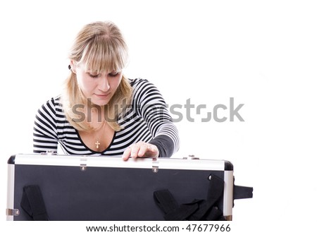 Woman packs a suitcase. - stock photo