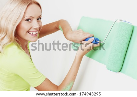 woman paint on the wall - stock photo