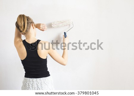 Woman paint wall - stock photo