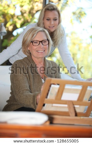 Woman painting a picture - stock photo
