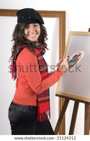 woman painting a picture in her work place - stock photo