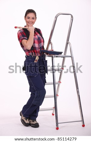 Woman painting a room red - stock photo